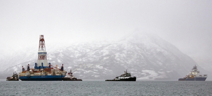 Salvage teams conduct an assessment of Shell's Kulluk drill barge on January 9th, 2013 in Kodiak Island's Kiliuda Bay in Alaska. (photo: Tim Aubry/Getty Images)