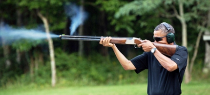 President Obama fires a rifle at Camp David. (photo: Pete Souza)