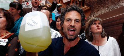 Actor Mark Ruffalo holds a bottle of well water from Dimock, Pa., during a New Yorkers Against Fracking rally at the Capitol in Albany, N.Y. (photo: Reuters)