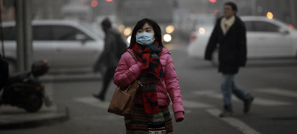 A woman wearing a mask walks along a street on a hazy day in Beijing, January 29, 2013. Beijing temporarily shut down 103 heavily polluting factories and took 30 percent of government vehicles off roads to combat dangerously high air pollution, state media reported on Tuesday, but the capital's air remained hazardous despite the measures. Picture taken January 29, 2013. (photo: Suzie Wong/Reuters)
