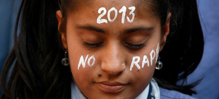 Enough is enough: A student prays for Jyoti. (photo: Reuters)