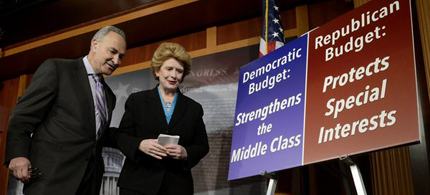 Democratic Senators Chuck Schumer, left, and Debbie Stabenow are seen at the conclusion of a news conference held by Senate Democrats on Capitol Hill. (photo: Michael Reynolds/EPA)