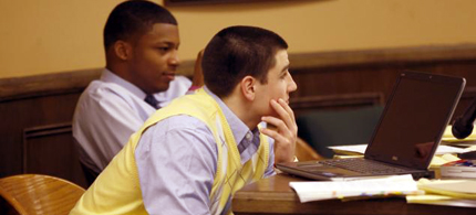 Trent Mays, 17, and co-defendant 16-year-old Ma'lik Richmond (back) sit at the defense table during a recess of their trial on rape charges in Steubenville, Ohio. Are they the scapegoats? (photo: AP)