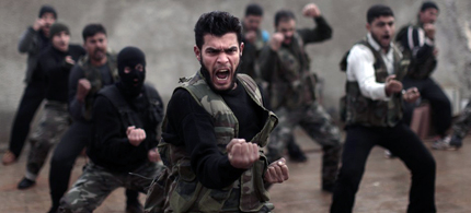Syrian rebels attend a training session conducted by US intelligence officers in Maaret Ikhwan, near Idlib, Syria. (photo: Muhammed Muheisen/AP)