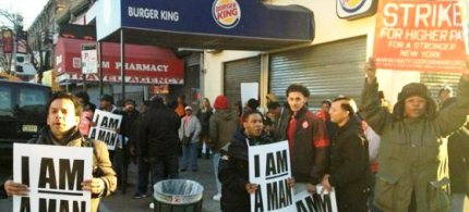 Workers strike outside a Burger King in Brooklyn in early April. (photo: NY Communities)