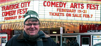 Michael Moore standing in front of the Traverse City Theatre. (photo: AP)