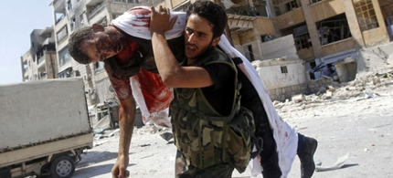 Free Syrian Army rebel trying to save his friend's life, November 2012. (photo: Reuters)
