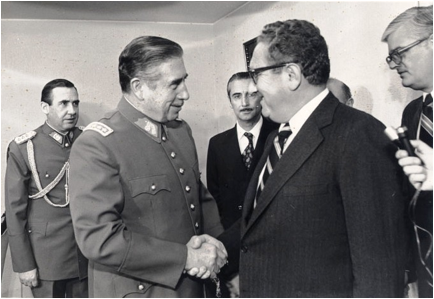 (Henry Kissinger shaking hands with Augusto Pinochet. Photo: Reader Supported News)