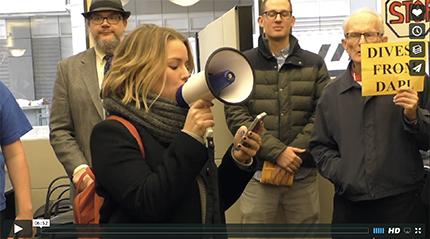 100 Iowans held a protest in the lobby of an Iowa Wells Fargo calling for divestment from the Dakota Access Pipeline. (Scott Galindez/RSN)