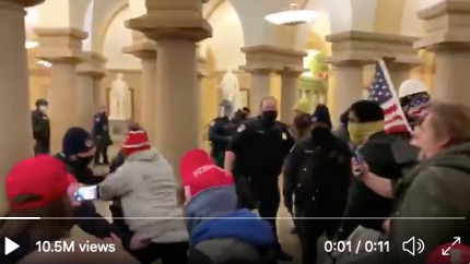 Trump-supporting extremists attack police in the United States Capitol building. (photo: BNO News)